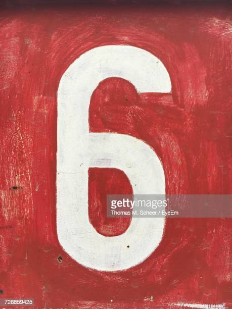 Number 6 On Red Wall