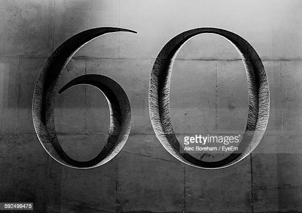number 60 carved on wall - number 60 stock photos and pictures