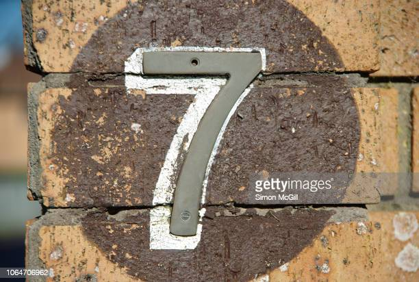 number 7 on a brick wall - seven stock pictures, royalty-free photos & images
