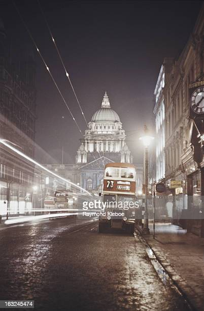 A number 73 bus to Ballygomartin Road on Linenhall Street Belfast with Belfast City Hall in the background Northern Ireland circa 1955