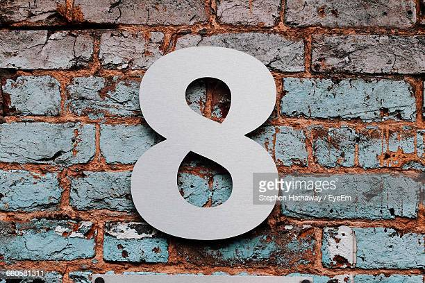 number 8 mounted on brick wall - number 8 stock pictures, royalty-free photos & images