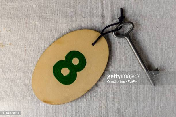 number 8 on wooden key ring - number 8 stock pictures, royalty-free photos & images