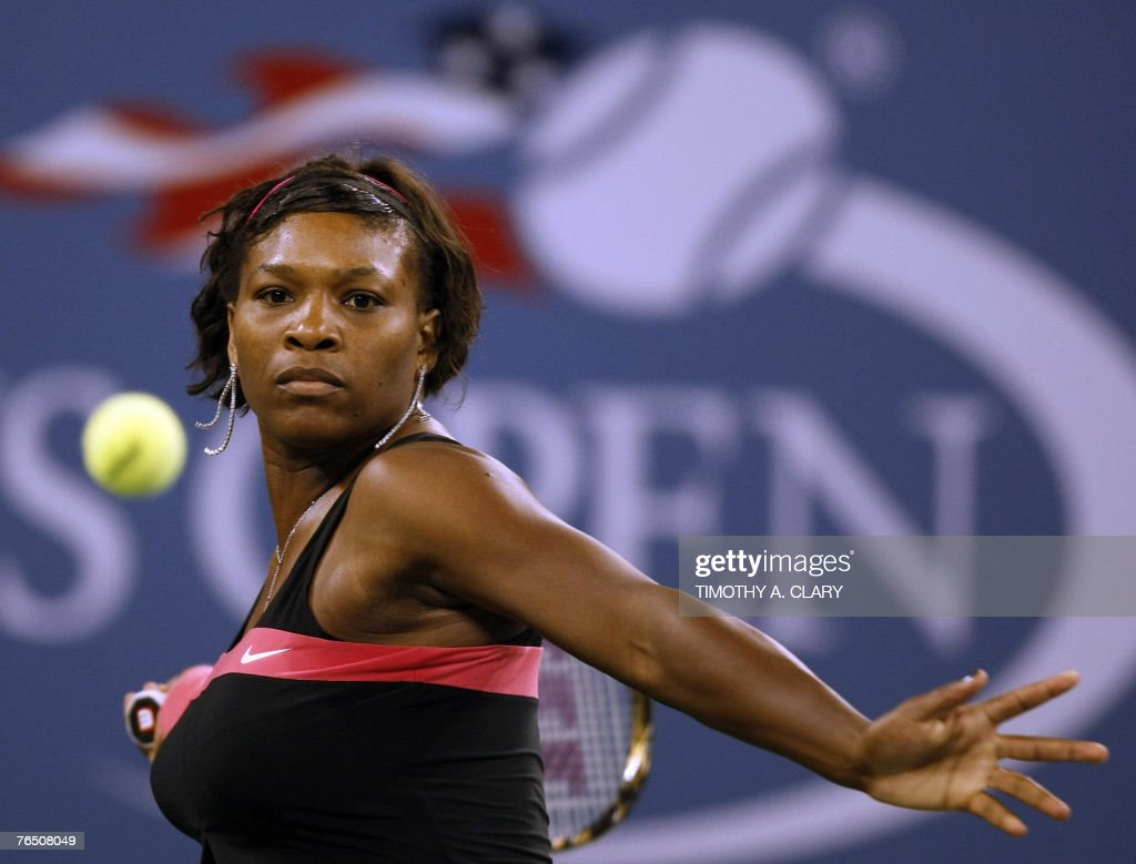 Number 8 seed Serena Williams of the United States against Number 1 seed Justine Henin from Belgium during their quarterfinal match of the US Open Tennis Championships at the USTA National Tennis Center in Flushing Meadows, New York, 04 September 2007.
