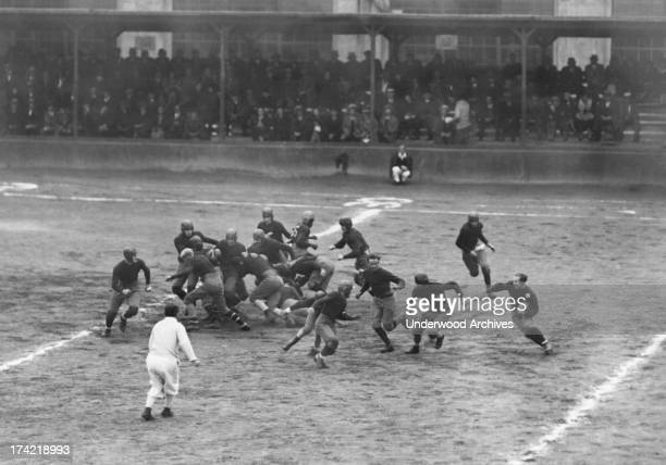 Number 82064 carries the football for the Sing Sing prisoners football team as they play aginst the Naval Militia team in Ossining New York 1929 Sing...