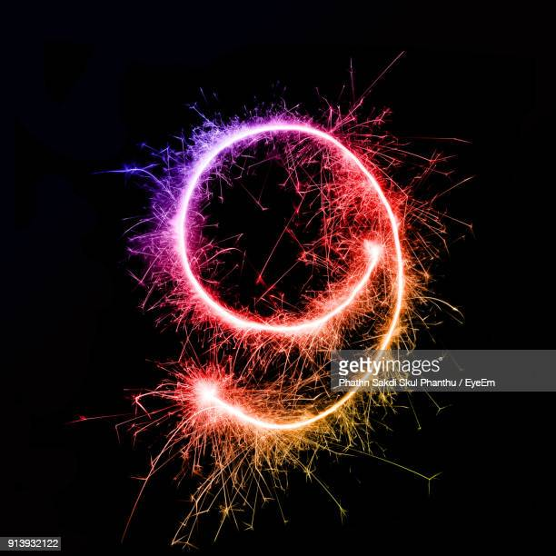 number 9 made by multi colored sparklers at night - number 9 stock pictures, royalty-free photos & images
