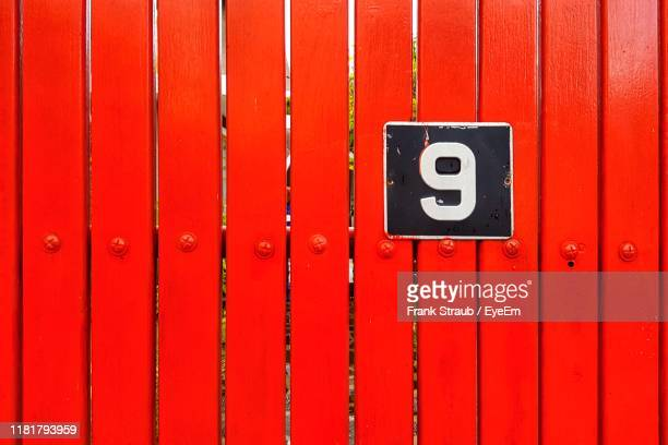 number 9 on red wall - number 9 stock pictures, royalty-free photos & images