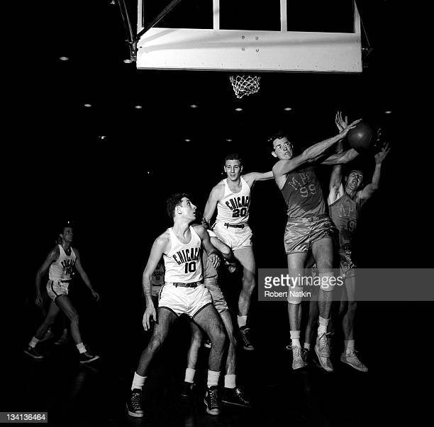 Number 99 George Mikan star center for the Minneapolis Lakers hauls down a rebound during a game against the Chicago Stags 1950