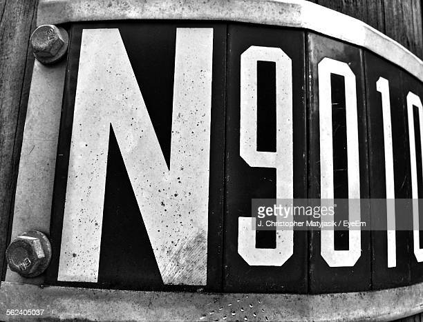 number board bolted on wall - letter n stock pictures, royalty-free photos & images