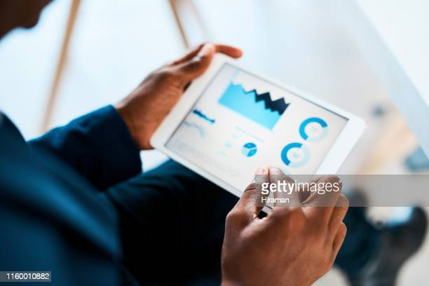 number crunching just got smarter - finance stock pictures, royalty-free photos & images