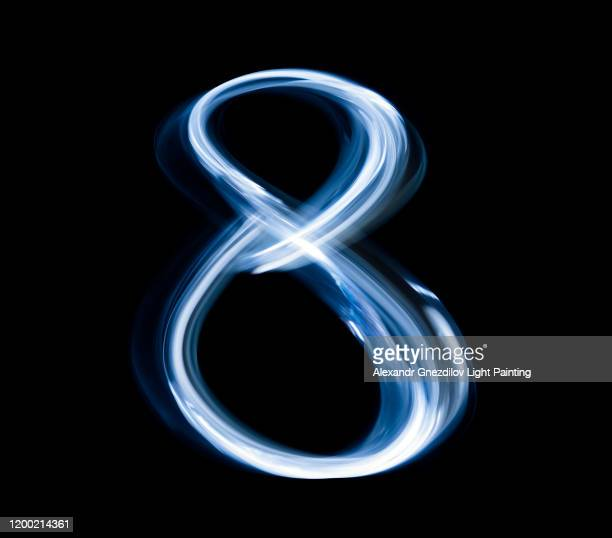 number eight drawn with a blue flashlight in a single photographic exposure - number 8 stock pictures, royalty-free photos & images