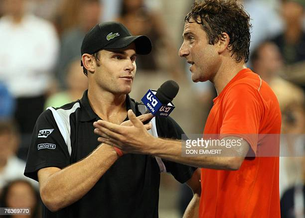 Number five seeded Andy Roddick of the US interviews compatriot Justin Gimelstob after their match 28 August 2007 at the US Open in Flushing Meadows...