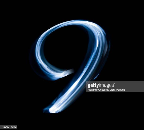number nine drawn with a blue flashlight in a single photographic exposure - number 9 stock pictures, royalty-free photos & images