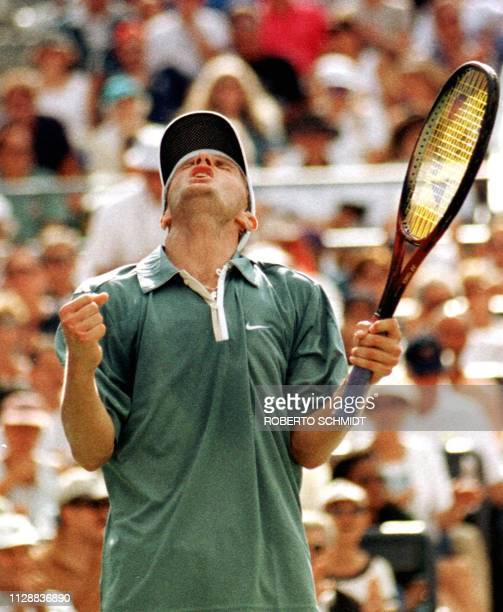 Number nine seeded Karol Kucera of Slovakia celebrates victory over number eight seeded Andre Agassi of the US 08 September at the US Open in...