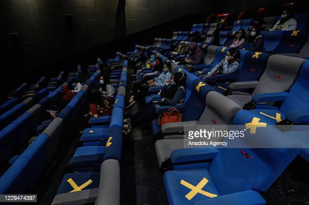 Number of audience wear face mask as they watch a film in a cinema in Palembang, Indonesia on November 05, 2020. The Palembang city government allows...