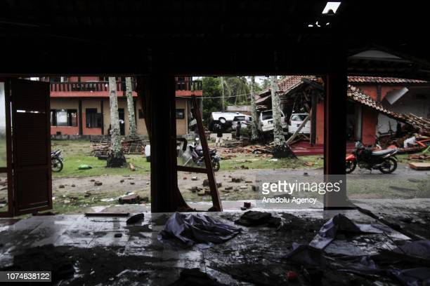 A number of buildings and vehicles are seen damaged due to being hit by a tsunami wave that hit the Pandeglang Serang South Lampung and Tanggamus...