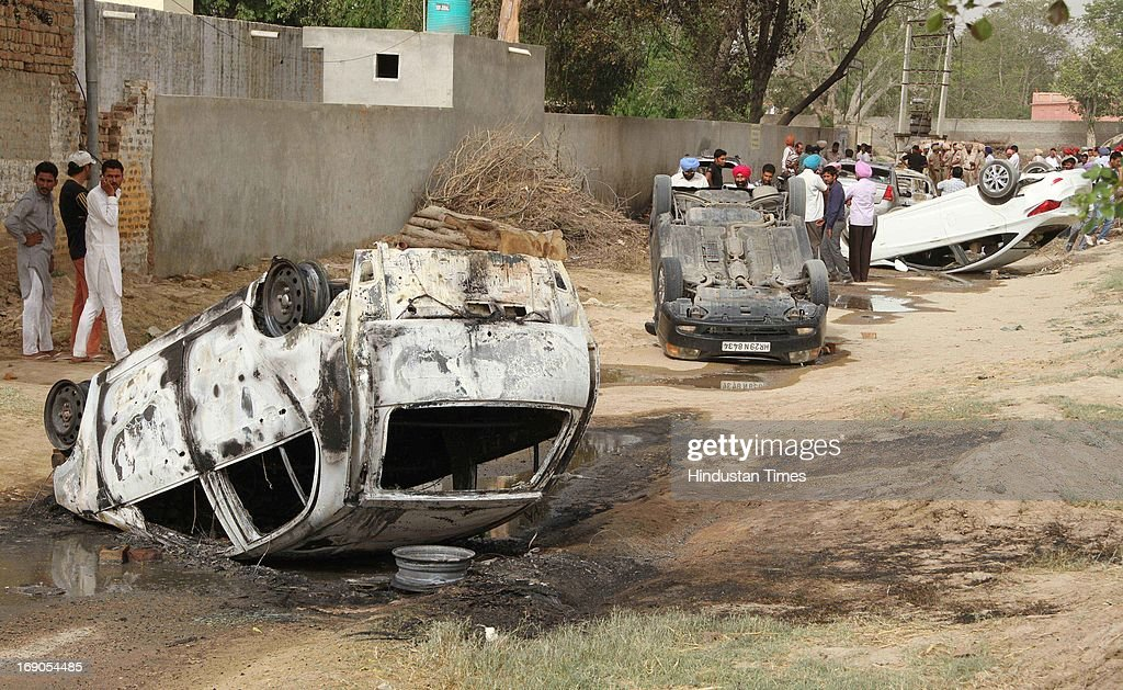 A number of cars were burnt during the Block Samiti And Zila Parishad Election at Mukatsar village Maan on May 19, 2013 in Bathinda, India. Elections were held today for district level. Several people and policemen were injured after clashes broke out between the workers of the ruling Akali Dal and the opposition Congress following alleged booth capturing by the Akali workers.