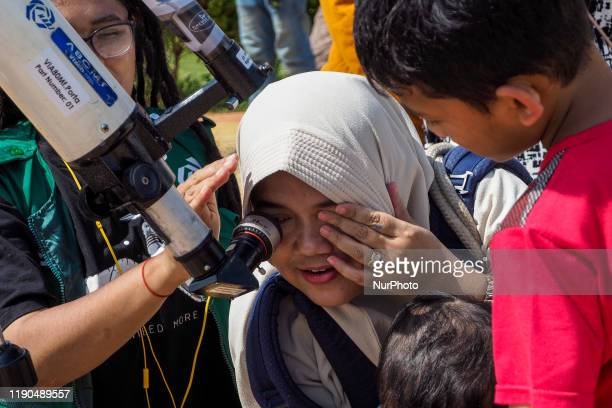 A number of citizens and foreign tourists witnessed the natural phenomenon of the solareclipse in Rbat archipelago Indonesia on December 26 2019...