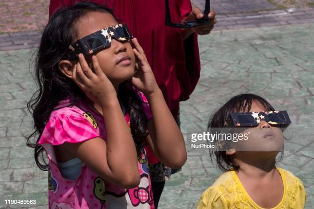 A number of citizens and foreign tourists witnessed the natural phenomenon of the solar eclipse in Rbat archipelago Indonesia on December 26 2019...