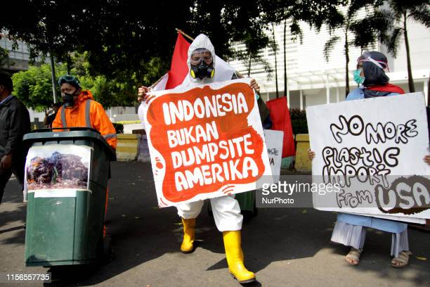 A number of environmental activists held a protest to rejecting an illegal household plastic waste from US in front of US embassy Jakarta on Friday...