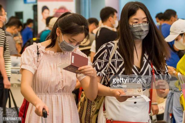 A number of foreign tourists from China walked to the departure lounge of Hang Nadim Airport Batam Riau Islands on January 28 2020 Chinese travel...