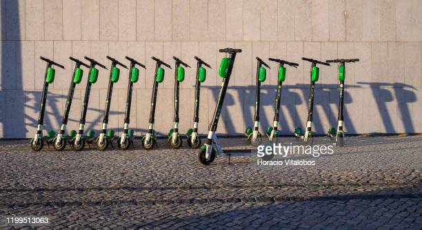 A number of LimeS escooters are parked in a neat row outside MAAT museum by the Tagus River on January 13 2020 in Lisbon Portugal Since their...