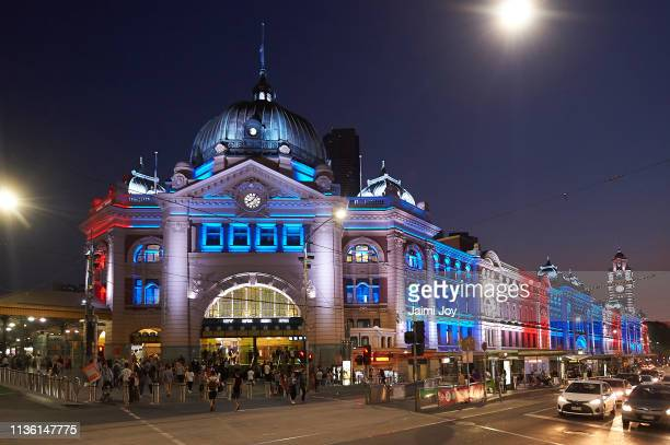 A number of Melbourne's landmarks are lit up in the New Zealand flag colours in a show of solidarity at Flinders St Station on March 16 2019 in...