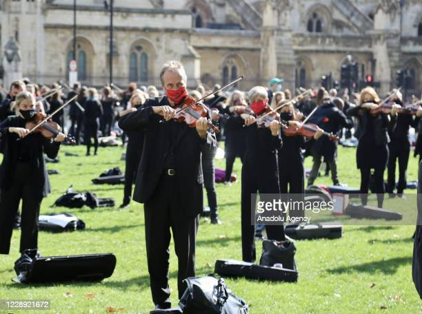 Number of musicians perform while demonstrating at London's Parliament Square against recent COVID-19 restrictions in London, United Kingdom on...
