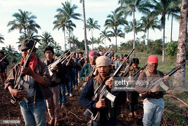 A number of New People's Army guerrillas assemble in a remote part of an island The communist rebels have been fighting a guerrilla war against the...