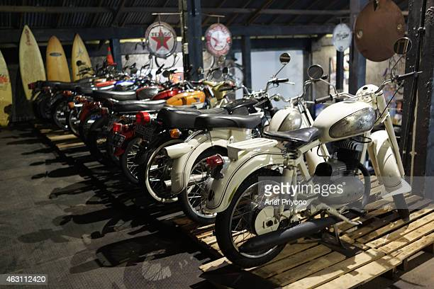 A number of old motorcycle parked as a display in ManShed Cafe Sanur The ManShed cafe in Sanur Bali is themed on an old style garage and is full of...