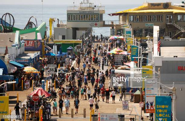 Number of people visiting the Santa Monica Pier ebs and flows as people take advantage of the warm weather during the COVID-19 Spring break in...