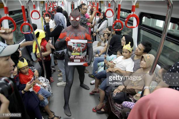 A number of Spiderman fans from the SpiderVerseid community wearing the Spiderman costume as they raising fund for charity on the train and stations...