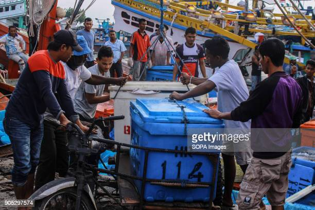 LHOKSEUMAWE ACEH INDONESIA A number of workers moved fish from ships to be auctioned at the traditional market of Lhokseumawe City The Indonesian...