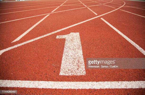 number on empty running track - number 1 stock pictures, royalty-free photos & images