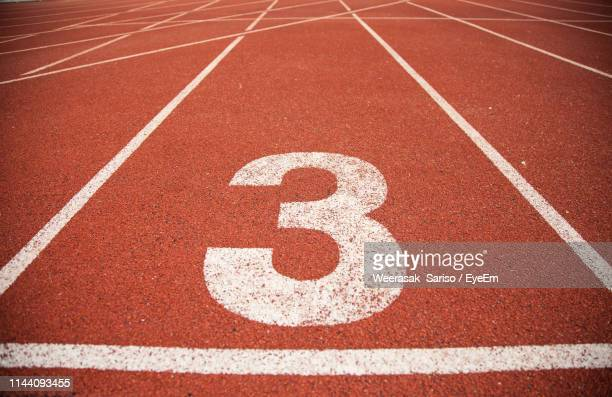 number on empty running track - number 3 stock pictures, royalty-free photos & images
