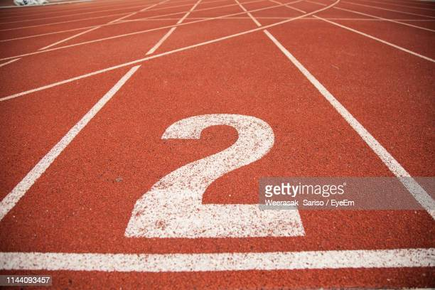 number on empty running track - number 2 stock pictures, royalty-free photos & images