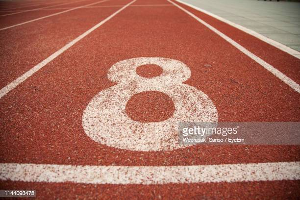 number on empty running track - number 8 stock pictures, royalty-free photos & images