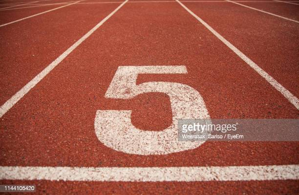 number on empty running track - number 5 stock pictures, royalty-free photos & images