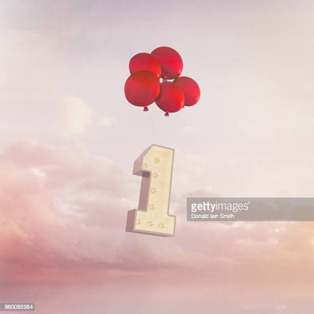 Number One floats away on red balloons