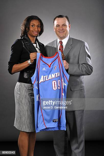 Number one overall pick Angel McCoughtry of the Atlanta Dream poses for a portrait with her college coach Jeff Walz of the University of Louisville...