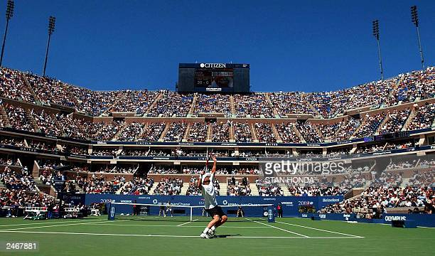 Number one seed Andre Agassi of the United States serves to number three seed Juan Carlos Ferrero of Spain in the Arthur Ashe Stadium during their...