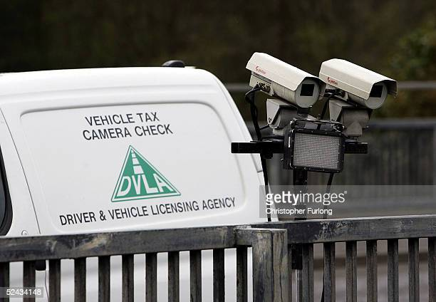 A number plate recognition camera operated by the UK's Driver and Vehicle Licensing Agency scans the M77 motorway for vehicles with invalid road tax...