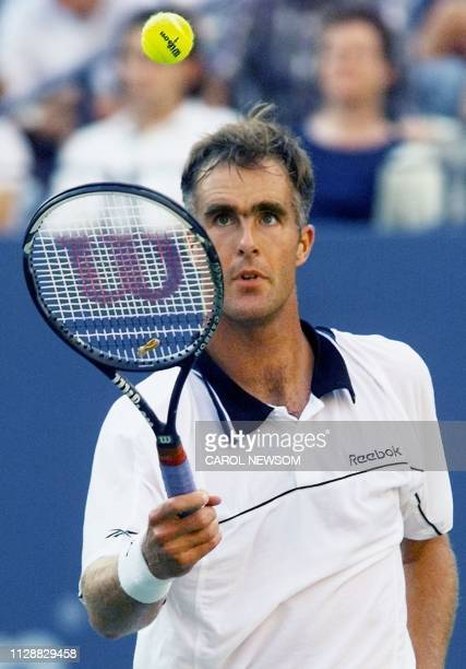 Number seven seeded Todd Martin of the US bounces the ball on his racquet during his match against number two seeded and compatriot Andre Agassi 12...