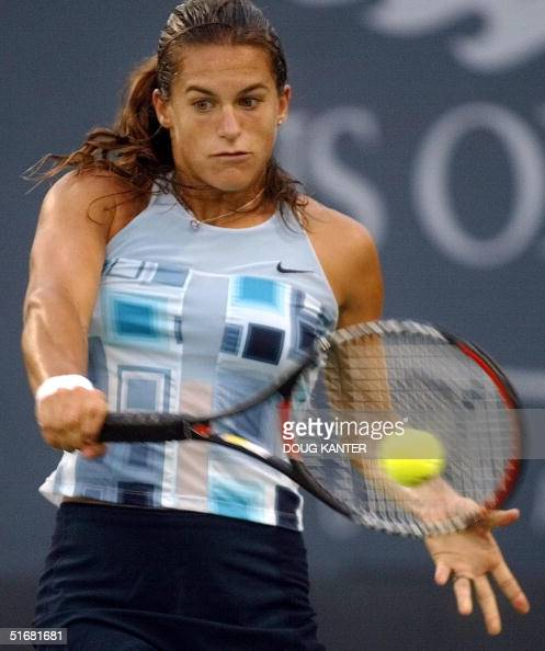 Number ten seed Amelie Mauresmo of France hits a b ...