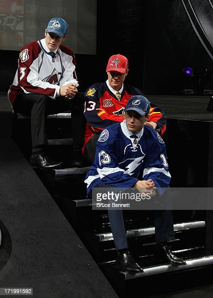 Number three over all Jonathan Drouin of Tampa Bay Lightning number one over all Nathan Mackinnon of the Colorado Avalanche and number two over all...