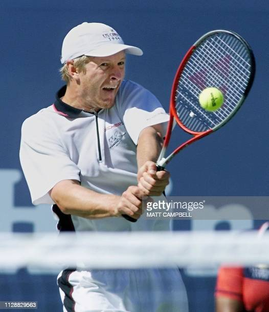 Number three seeded Yevgeny Kafelnikov of Russia returns a backhand to number two seeded Andre Agassi of the US 11 September at the US Open in...