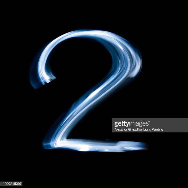 number two drawn with a blue flashlight in a single photographic exposure - number 2 stock pictures, royalty-free photos & images