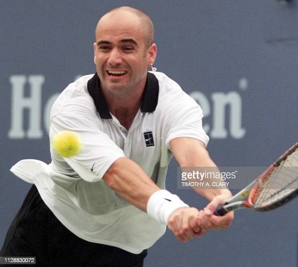 Number two seed Andre Agassi of the US stretches for a return to Justin Gimelstob of the US 04 September 1999 at the US Open in Flushing Meadows New...
