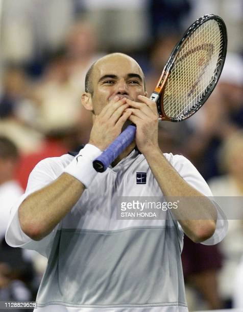 Number two seeded Andre Agassi of the US blows a kiss to the crowd after his victory over compatriot and number seven seeded Todd Martin of the US 12...