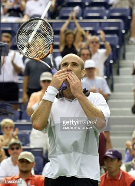 Number two seeded Andre Agassi of the US blows a kiss to the crowd after his victory over Germany's Axel Pretzsch 02 September 1999 at the US Open in...
