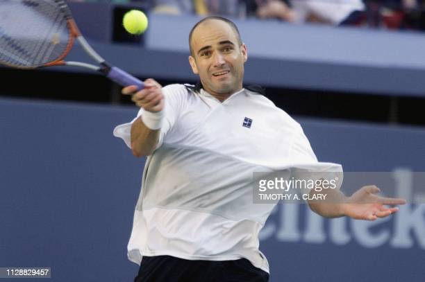 Number two seeded Andre Agassi of the US hits a forehand return to compatriot number seven seeded Todd Martin 12 September at the US Open Men's...